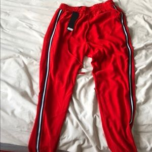 Red pants with black and white strips